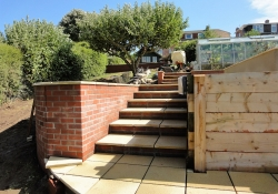 Terracing with a mix of materials to provide interest in a gardener's garden